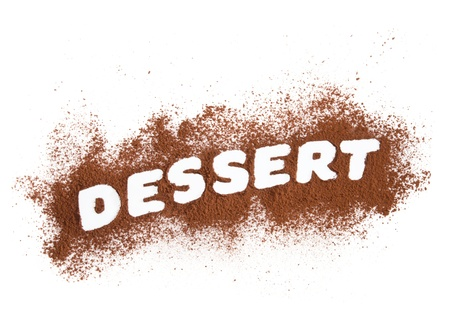 Dessert word written with cocoa powder photo