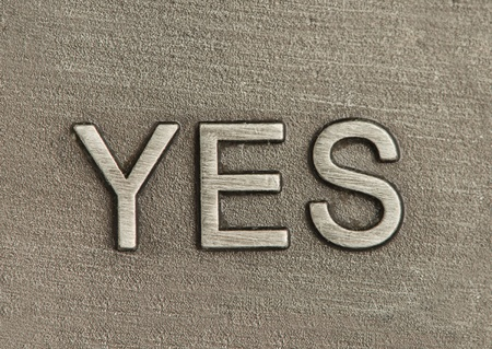 Yes engraved in metal plate Stock Photo - 21524675