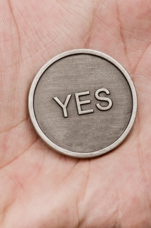 flipped: Flipped coin on a hand background Stock Photo