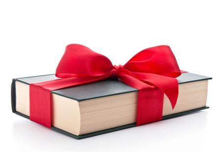 Book wrapped with a ribbon Фото со стока