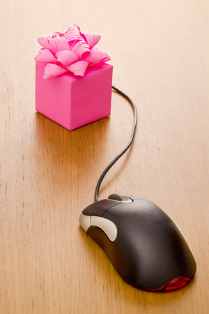 Gift box on a desk with mouse attached photo