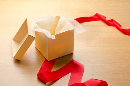 reveal: Open gift box with red ribbon