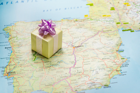 Wrapped gift on Europe map photo