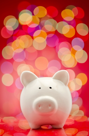 sales bank: Piggy bank with party lights background