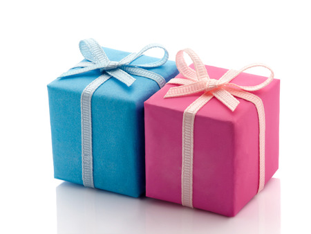 Two gift boxes wrapped in different colored paper, blue and pink