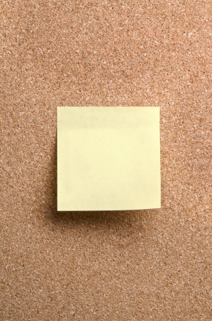 sticky note on cork board background photo