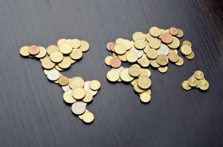 international money: Global money map. World map made of money coins Stock Photo
