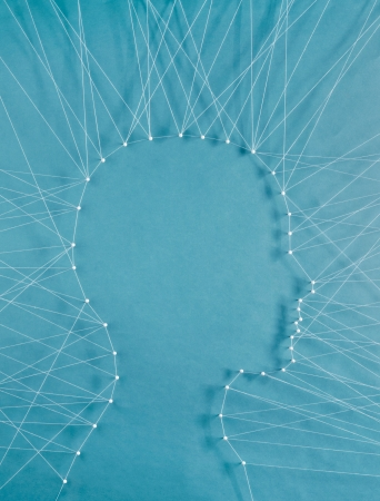 The head of a man connected to exterior by threads Stock Photo
