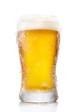 Frosty pint glass of beer isolated on a white background photo