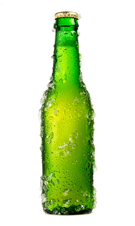 Chilled isolated green beer bottle with drops and ice Фото со стока