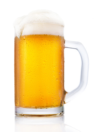 Frosty mug of beer isolated on white background photo