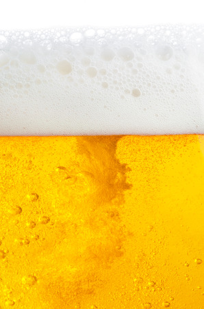 Beer with bubbles and foam photo