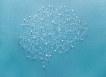 Neural network created by pins and threads photo