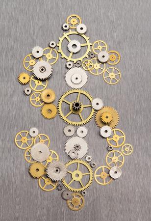 Time is money. Dollar sign formed by clockworks