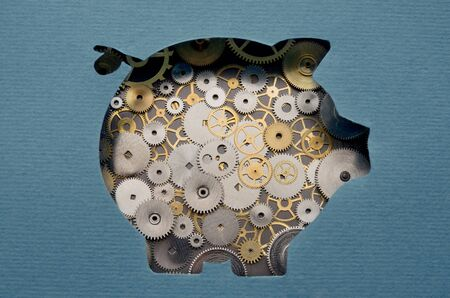 partnership security: Financial savings mechanism. Piggy bank formed by gears and cogs Stock Photo