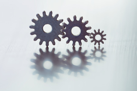Metal gears. Close-up of two steel gears linked concept for love, family, teamwork and partnership photo
