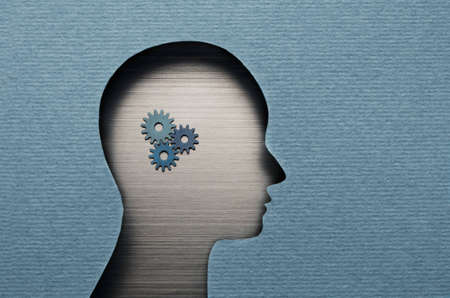 decisionmaking: Thinking Mechanism. Human head with gears inside
