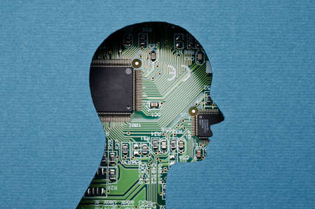 Cardboard human head cutout revealing circuit board content