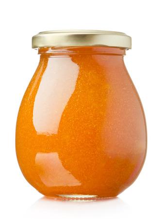 Apricot jam glass jar isolated on white background Фото со стока