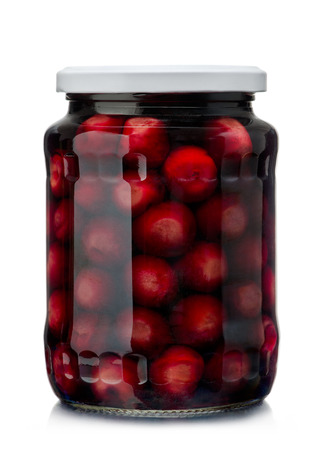 sour cherry: Jar of cherry compote isolated on white