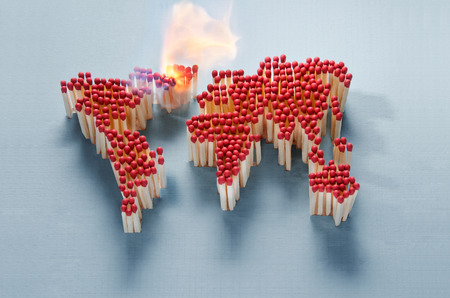 World map made of matches waiting for a spark photo