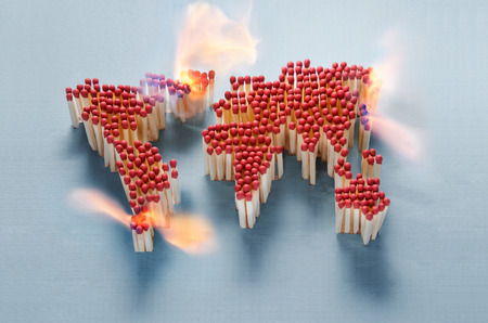 world wars: World map made of matches waiting for a spark Stock Photo