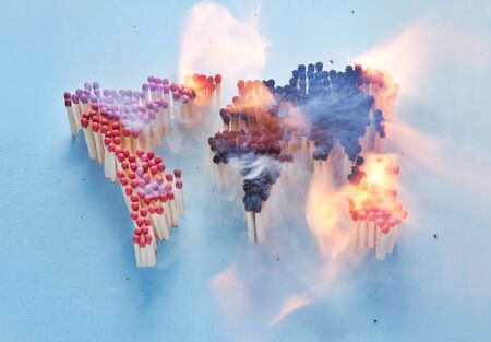 hot climate: Burning world map made up of matches