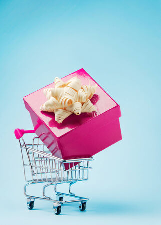 sold small: Shopping cart with large gift