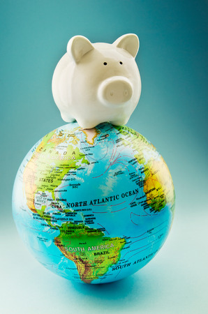 holiday profits: Piggy bank around the world Stock Photo