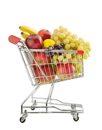 consumable: Shopping trolley full of fresh fruits isolated on a white background Stock Photo
