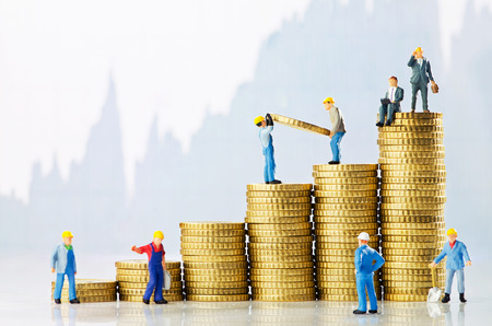 miniature people: Working men creating business growth Stock Photo