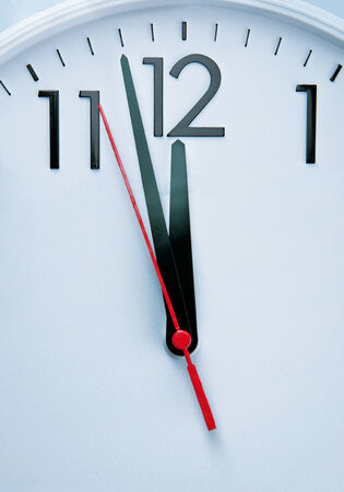 oclock: The stressing clock hitting 12 Oclock Stock Photo