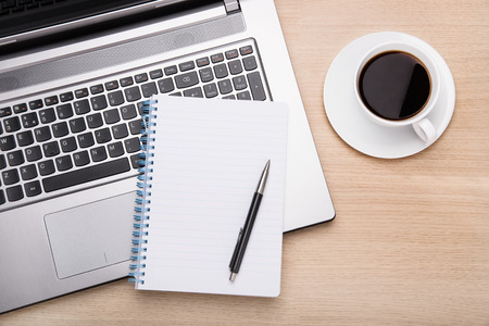 Coffee,laptop and paperwork on office desk