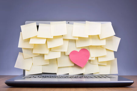 post it: Coloured post-it notes covering laptop screen