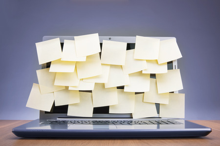 absence: Coloured post-it notes covering laptop screen
