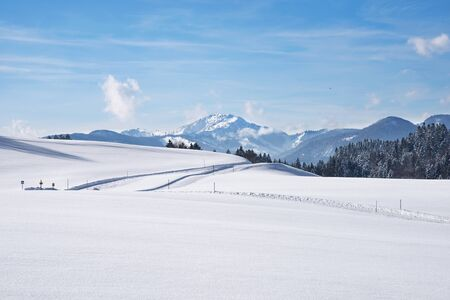 snow covered mountain: Ski tracks in the snow covered landscape Stock Photo