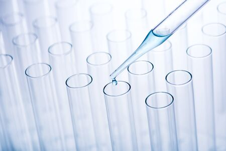 Scientific research. Laboratory pipette used to transfer a small amount of liquid to a test tube