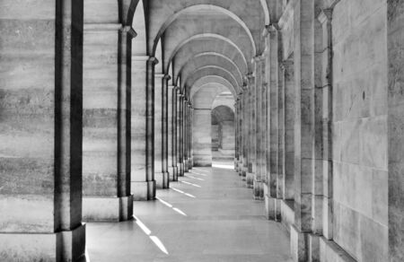 leading: Passage leading towards archway at colonnade
