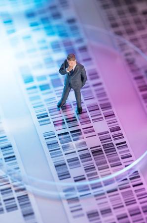 Man looking at DNA gel into petri dish photo