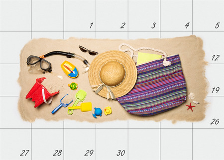 dream planning: Summer holiday planning. Summer beach accessories on top of monthly calendar Stock Photo