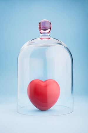 under heart: Red heart protected under a glass dome on blue background