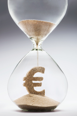 Time is money concept with falling sand taking the shape of a euro Stock Photo