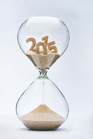Time running out concept with hourglass falling sand from 2015