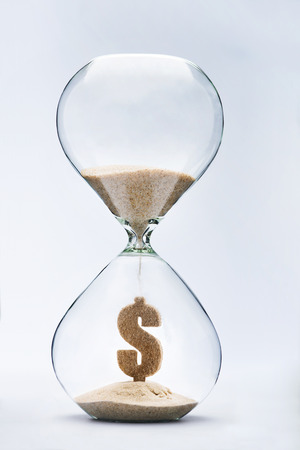 Time is money concept with falling sand taking the shape of a dollar Standard-Bild
