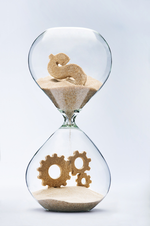 Money makes the world go round. Capitalism. Dollar sign flowing down in hourglass resulting cooperation
