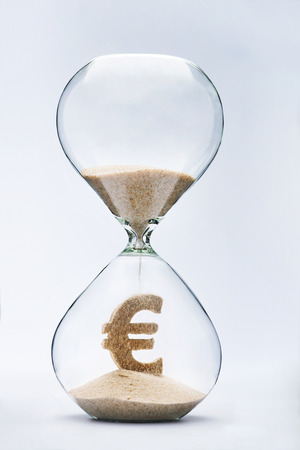 Time is money concept with falling sand taking the shape of a euro Standard-Bild