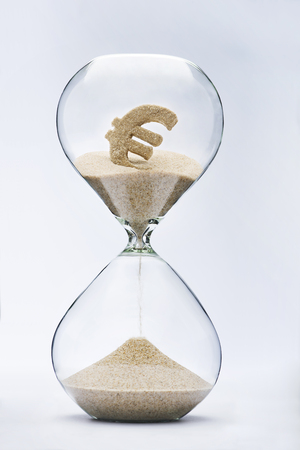 Time is money. Euro sign flowing down in the hourglass.