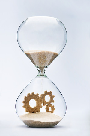 Connected gears made out of falling sand inside hourglass