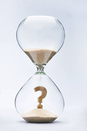 responsibility survey: Question Mark made out of falling sand inside hourglass Stock Photo
