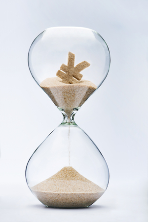 fall time: Time is money. Yuan sign flowing down in the hourglass.
